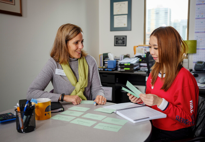 Student working with an advisor