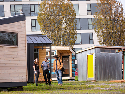Portland State University professor and two students working on a tiny house project