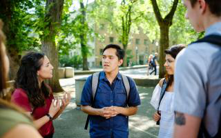 Members of student government having a conversation in the park blocks.